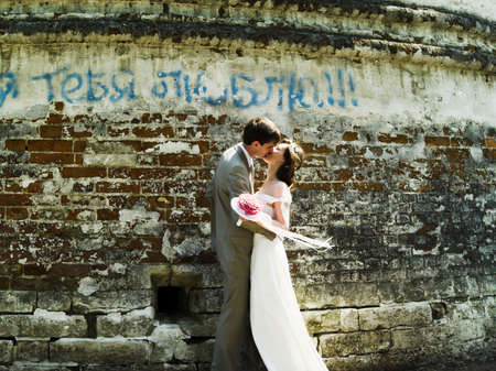 nuptial: Kissing happy couple