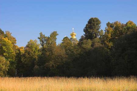 Field near christian church in New Jerusalem near Istra, Moscow region, Russia photo