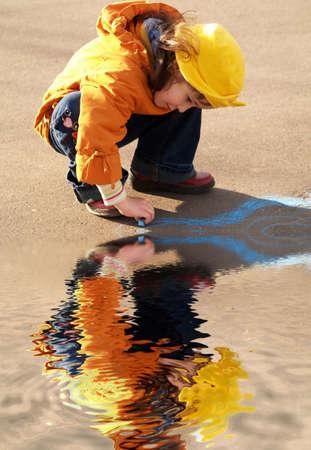 Orange painting girl near the water