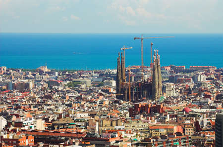 Panorama in Barcelona, Sagrada familia and many roofs Editorial