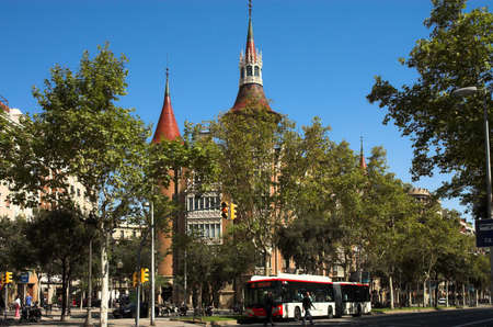 catalunia: House with spires in Barcelona city and bus, Catalunia, Spain Stock Photo
