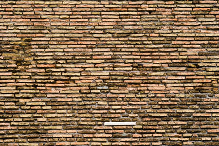 stone cold: Old colourful brick wall of building, texture and background
