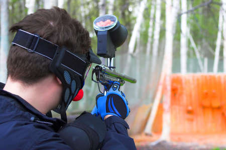 Man in paintball mask aim at target wall Stock Photo - 1260805
