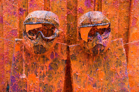 Colored vivid paintball sport protection masks on the fence Stock Photo - 1260843