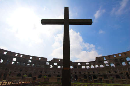 Cross inside of Colosseum  in Rome (Flavian Amphitheatre), Italy photo
