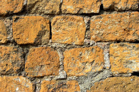 heterogeneous: Old orange and grey brick wall, texture and background