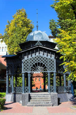 grates: pergola with iron columns,grates,marble staircase and dome