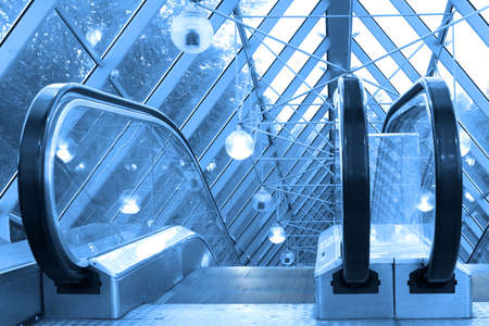 Mooving escalators and stairs, bridge with spheres photo