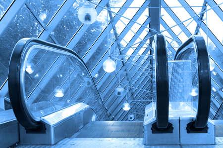 Mooving escalators and stairs, bridge with spheres Stock Photo - 2032545