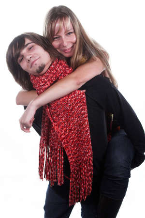 handsome guy with red scarf holds beautiful girl photo
