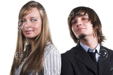 handsome guy and beautiful girl with soapy bubbles photo