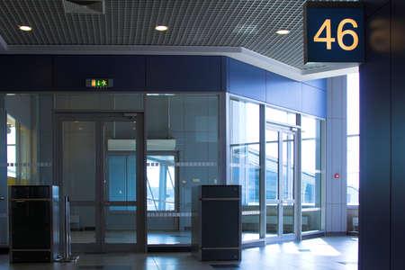 Blue gate 46 in airport terminal photo