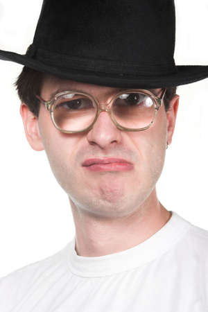 animosity: crazy man in hat and glasses Stock Photo