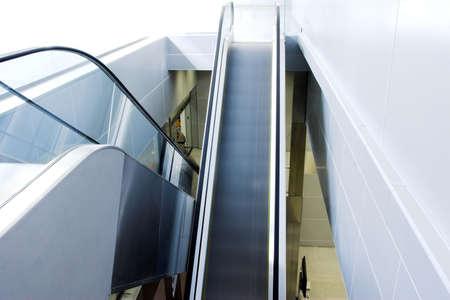 Mooving escalators in airport photo