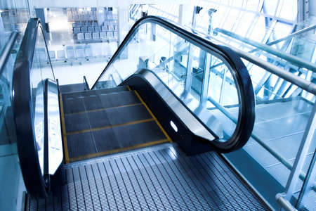moving  escalator in the office hall perspective view Stock Photo
