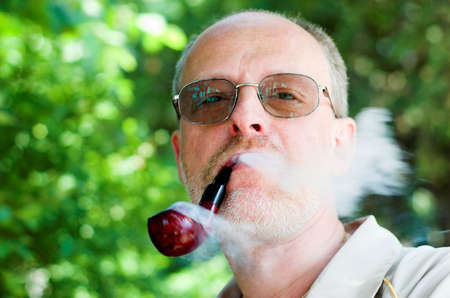 Adult man with glasses and wooden pipe Stock Photo - 2738076