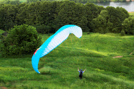 paraglide: colorful extreme paraglide and green grass Stock Photo