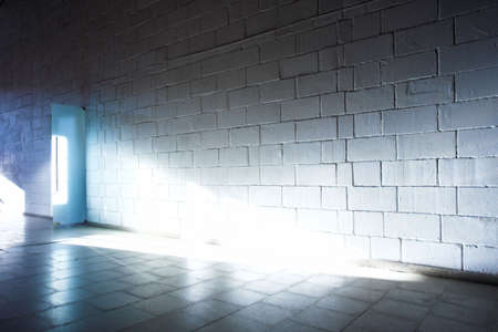 gallerie: White brick wall and light ray Stock Photo