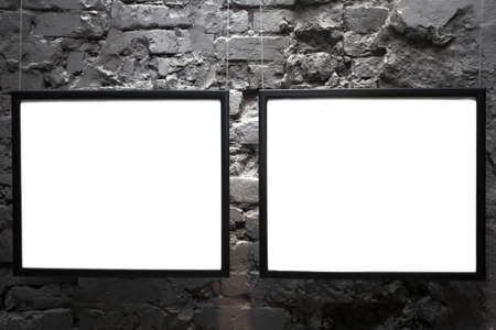 proto: Two empty frames on brick wall in museum