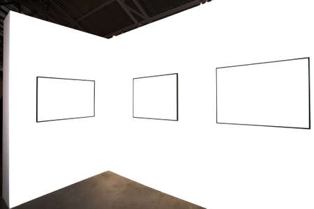 proto: Three empty frames on white wall in museum