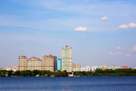 erect: Moscow cityscape near river, blue sky Stock Photo