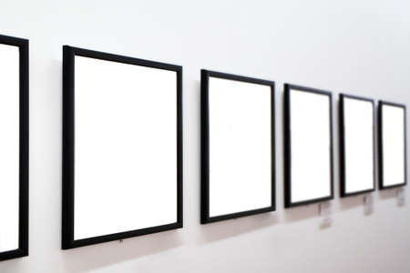 proto: empty frames on white wall in museum