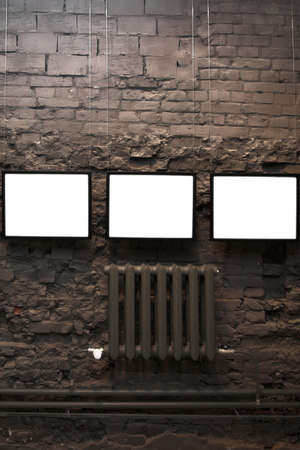 gallerie: Four empty frames on brick wall in museum Stock Photo