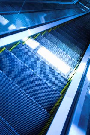 Blue move escalator in modern office centre Stock Photo - 3179417