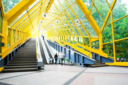 Mooving escalators and stairs, bridge with spheres Stock Photo