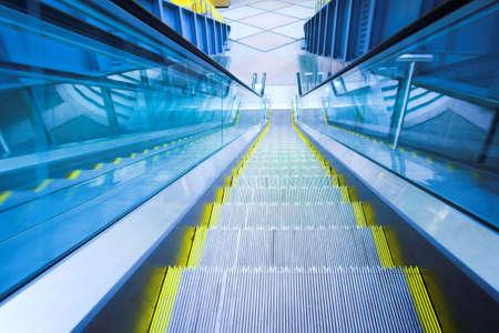 Blue move escalator in modern office centre Stock Photo - 3179402