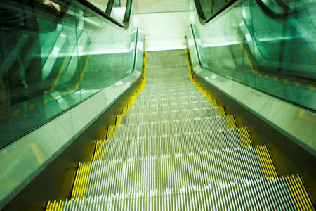 Green move escalator in modern office centre Stock Photo - 3179395