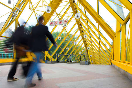 elevated walkway: Yellow corridor, spheres and people motion