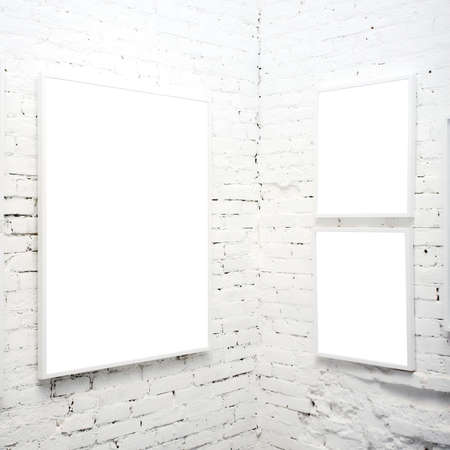 cadre: brick wall in museum with empty frames Stock Photo
