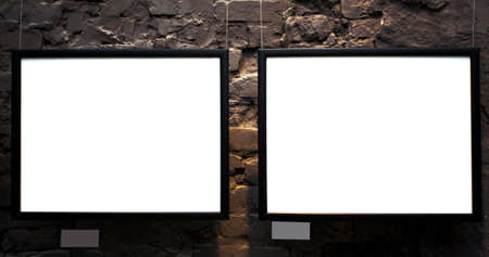 Two empty frames on brick wall in museum photo