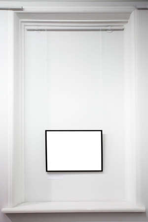 empty frame on white wall in museum photo