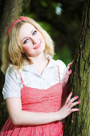 Blonde smile beautiful girl portrait near tree photo