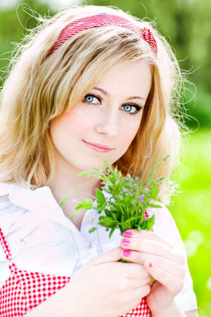 Blonde beautiful girl portrait with small flowers photo