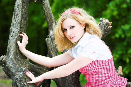 Blonde beautiful girl on tree as a tiger photo