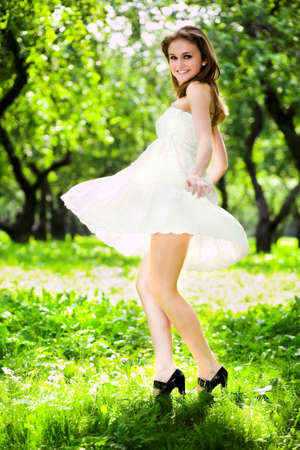 young teen girl nude: Smile girl dance in white dress in park