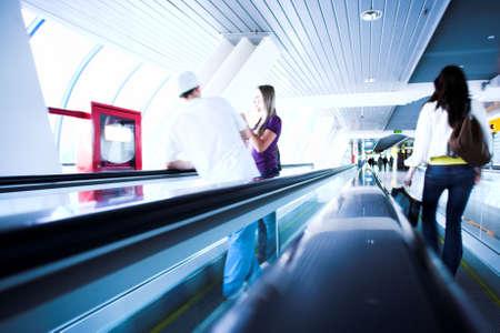 Move people on escalator in glass bridge photo