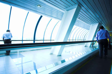 Move people on escalator in glass bridge photo