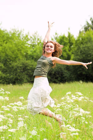 beautiful girl jumping in park on meadow Stock Photo - 3242262