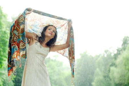 Girl stay under rain drops cover shawl Stock Photo - 3242275