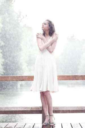 Girl portrait stay under rain drops photo