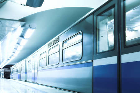 Blue fast train stay at hall platform photo