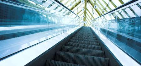 Blue move escalator in modern office centre Stock Photo - 3511701