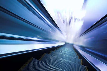 Fast moving escalator in shopping center Stock Photo - 3603755