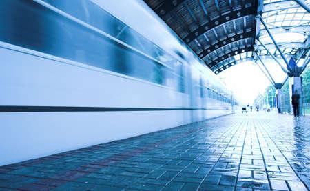 train move on wet platform in subway photo