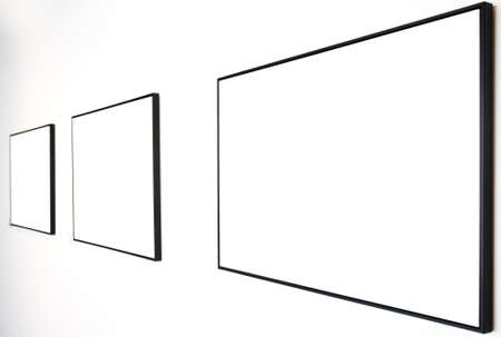 blank canvas: Three empty frames on white wall in museum