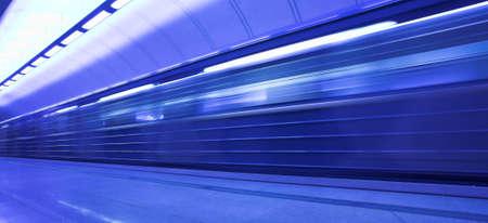 mooving train on platform in subway  photo